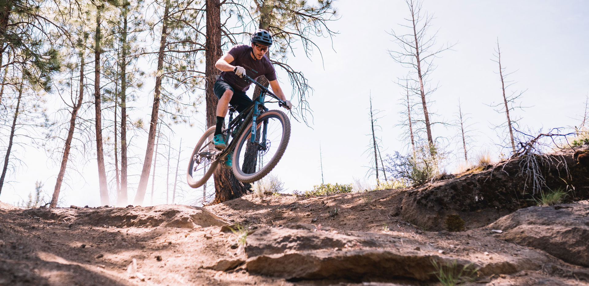 Specialized Epic Evo S-Works rider in the air
